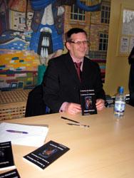 Alistair MacIntyre wth his new book
